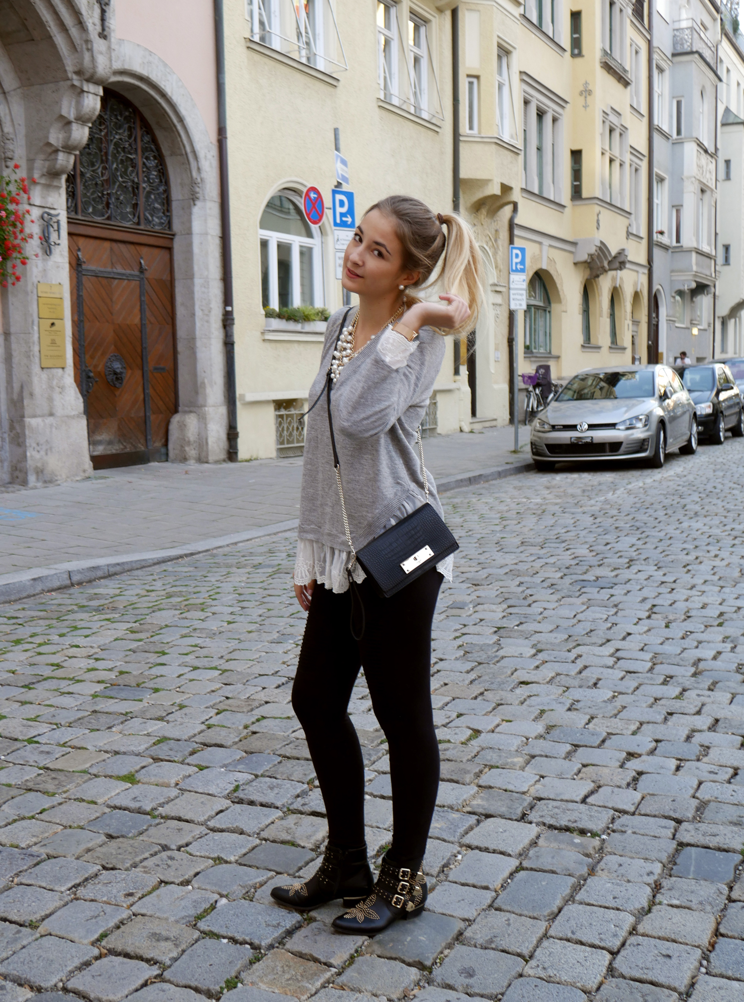 Lace-Sweater-and-studded-boots-layering-look-munich-shirt-biker-nieten-tanja.jpg